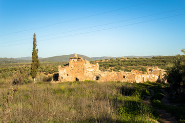 Old, abandoned and damaged farmhouse in Andalusia, Spain on a day in spring