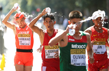 Athletes cool off during the junior men's 10 kilometres race walk at the World Race Walking Team Championships in Rome