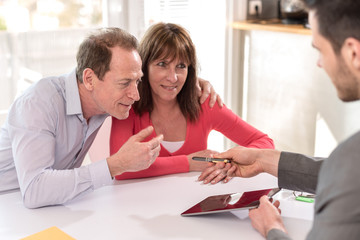 Senior couple meeting realtor for investment