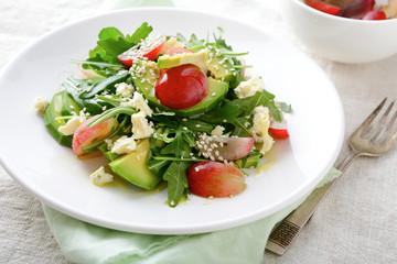 Avocado Salad with grape, arugula, blu cheese and sesame