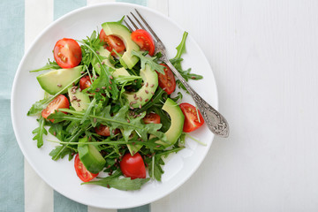 Fresh Avocado Salad with cherry tomatoes and arugula