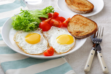 Breakfast - Fried Eggs, bread, tomato and lettuce