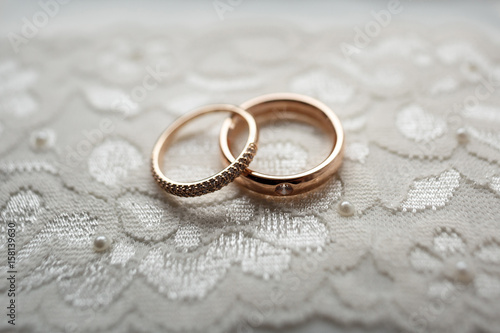 Golden Wedding Rings Lie On White Cloth Stock Photo And Royalty