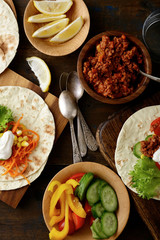 Tacos with ground meat and different vegetable