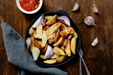 Roasted potatoes in a pan on the table