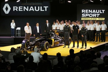 Renault Chief Executive Ghosn, Renault Formula One racing driver Magnussen and teammate Palmer unveil the new Renault RS16 car during its official presentation at the company's research center in Guyancourt