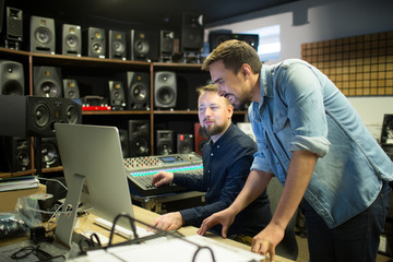 People discussing in music studio