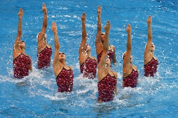 Members of Japan's synchronised swimming team perform during a training session at a pool in Tokyo