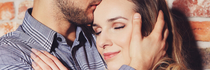 Relationship embracing with eyes closed