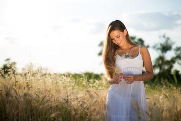 Beautiful carefree woman in fields