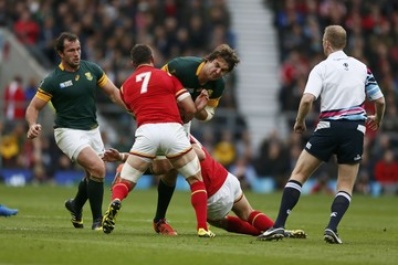 Lood de Jager of South Africa is tackled by Sam Warburton of Wales during their Rugby World Cup Quarter Final match at Twickenham in London