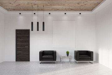 Waiting area with vertical poster and armchairs