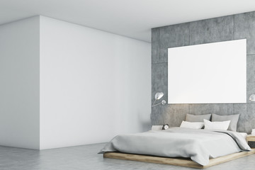 Gray bedroom with poster and study side