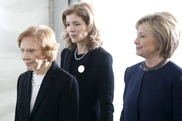 Former first lady Rosalynn Carter, Caroline Kennedy, and Hillary Clinton walk to the grave site after the funeral of Nancy Reagan at the Ronald Reagan Presidential Library in Simi Valley, California