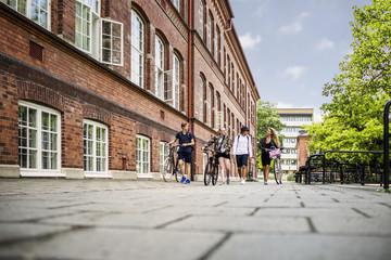 Students (14-15) walking by school