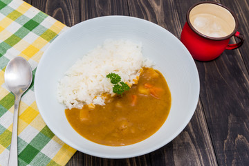 Japanese curry rice on vintage wooden table