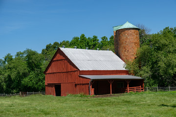 Barn with silo and pasture