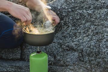Man preparing food on camping stove