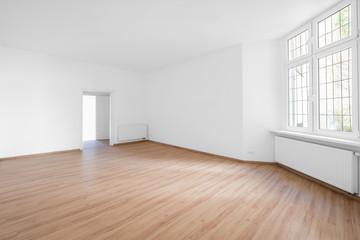empty room, wooden floor in new apartment