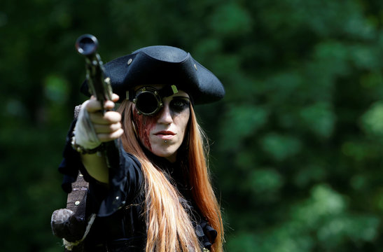 A reveller attends the Victorian Picnic during the Wave and Goth festival in Leipzig