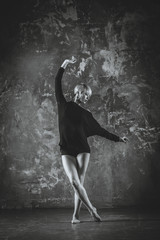 Dance. The girl dances in a black jacket