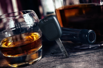 Car keys on glass with alcohol drink, drive under alcohol influence concept