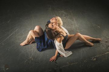 Two girls dance a dance