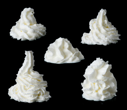 whipped cream on a black background
