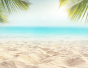Sand with blurred Palm and tropical beach bokeh background, Summer vacation and travel concept. Copy space