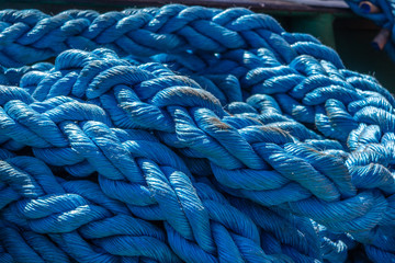 Pile of huge blue woven rope.