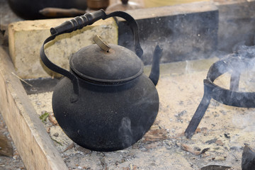 Kettle surrounded by water vapor and smoke