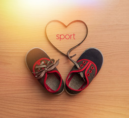Children's shoes as a symbol of love for the sport