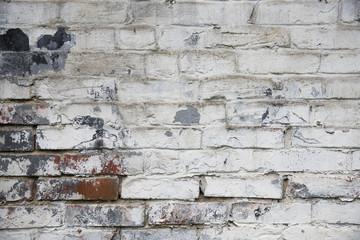 Fragment of whitewashed old brick wall, background