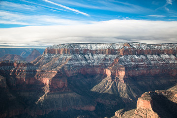 view over the north rim part in grand canyon with snow from the helicopter Papier Peint