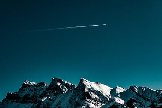 Plane Flies over Mountains
