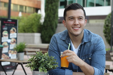 Man taking a break with a cold refreshing orange juice
