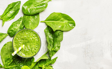 Cocktail of spinach and green vegetables and fruit, drink background, top view