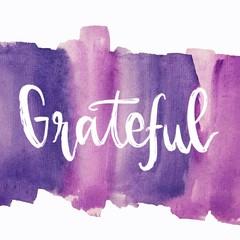 Grateful message written on purple background