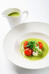 cream soup with tomato and mozzarella