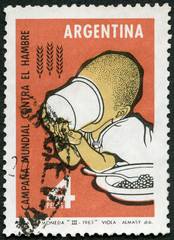 ARGENTINA - 1963: shows Child Draining Cup, FAO Freedom from Hunger campaign