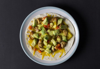Open wrap with chicken, avocado and peppers