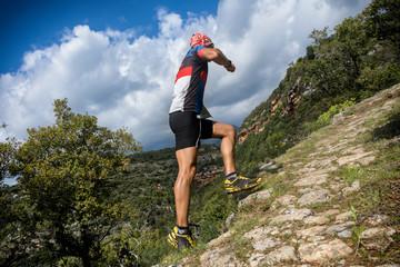 trail runner on vertical uphill race