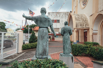The Church of St. Francis Xavier (Malay: Gereja St. Francis Xavier) with bronze saint sculptures in Melaka City, Melaka, Malaysia.