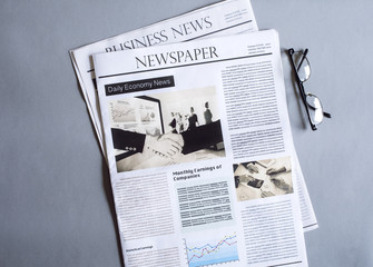 Newspaper on gray background