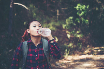 Close up of young hiker drinking water at mountain.