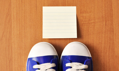 Sports baby sneakers on wood background