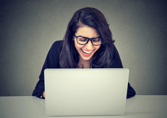 Smiling woman working with laptop