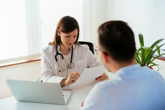 Cheerful doctor gives good news to patient