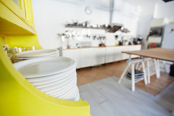 Stack of clean porcelain plates in the kitchen