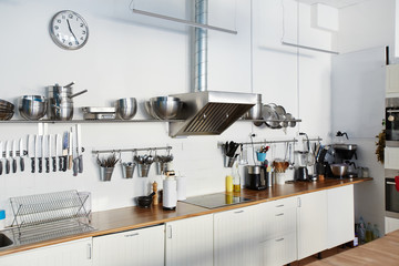 Various kitchenware on workplace of chef
